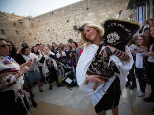 "Women of the ""Women of the Wall"" organization dance with the Torah scroll as they attend their monthly prayer services at the Western Wall in Jerusalem, April 20, 2015."
