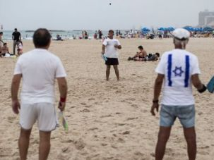 Games Go On: Most Israelis are taking the conflict in Gaza, and the barrage of rockets, in stride. It's not so easy for American vacationers.