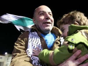 Home Free: Freed Palestinian prisoners are greeted as they arrive at the Muqataa Presidential Compound in Ramallah, West Bank.