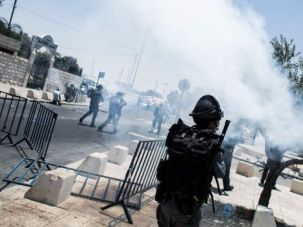 Israeli soldiers fire tear gas at Palestinian protesters in east Jerusalem after the funeral for revenge victim Mohammed Abu Khdeir.