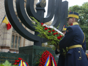Remembrance: Romanian Jews place wreath at Holocaust memorial.