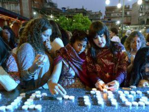 Annual Rite: Jewish women light candles at last year?s Passover seder in Kathmandu, Nepal.