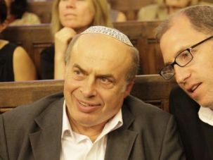 Jewish Agency Chairman Natan Sharansky, left, with the organization's head of French operations, Ariel Kandel, at a Paris synagogue.