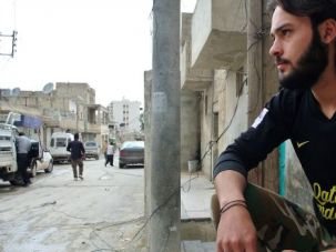 Rising Brutality: Syrian rebel stands guard in city of Alleppo. A video of a rebel commander cutting the heart out of a government soldier has raised new alarm about the brutal civil war.