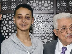 Young Victim: Beaten American teenager Tariq Khdeir meets with Palestinian President Mahmoud Abbas.
