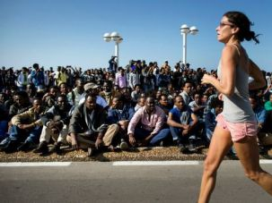 Paying No Mind: Thousands of African immigrants rallied for their rights in Tel Aviv. Some Israelis praised the protests, others objected, and some simply went about their business as usual.