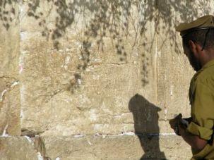 Fitting In: An Ethiopian-Israeli soldier prays at Western Wall in Jerusalem.