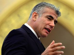 Take Responsibility: Israeli Finance Minister Yair Lapid addresses conference on anti-Semitism in Budapest.