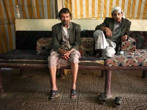 ?No Place Like Yemen?: The few remaining Jews in Yemen have little left but themselves and their traditions. Moussa Marhabi, left, and his son, Yousuf Salem Marhabi, rest during a wedding.