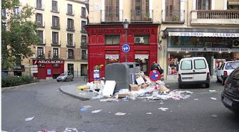 Trash : Madrid?s streets were strewn with garbage.