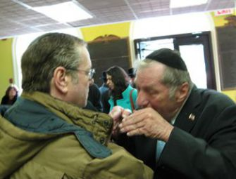 Pushing Back: David Framowitz and Ronald Greenwald debate tactics at a March 1 rally against sexual abuse in the Orthodox world.