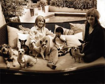 All in the family: Carol Leifer, at right, with her partner Lori Wolf, son Bruno, and dogs Heston, Julius, Maccabee, Shelby, Albert, Cagney and Lacey.