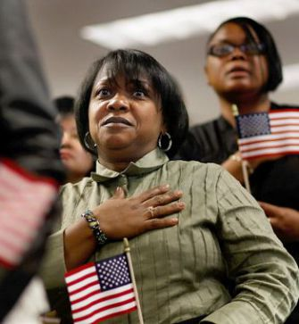 Pledging Allegiance: Maria Elena Santana Acevedo, originally from the Dominican Republic, recites the oath as she becomes an American citizen on May 14 in New York City. In Israel, the Cabinet has approved a highly controversial loyalty oath for non-Jewish immigrants.