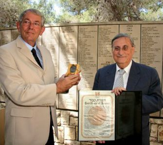 Investigator: Jacob Turkel, right, a former Israeli Supreme Court Justice, presents an award at Yad Vashem in 2008.