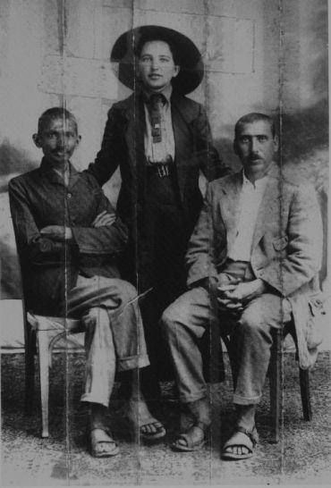 Gandhi (Left), Sonia Schlesin, his secretary (Center), and Dr. Hermann Kallenbach. Kallenbach sewed this photo in the collar of his jacket before joining Gandhi in England during the First World War.