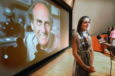 Alexis Steinman, daughter of deceased 2011 Nobel Prize in medicine winner Ralph Steinman, speaks at a press conference in front of a photo of her father at Rockefeller University.