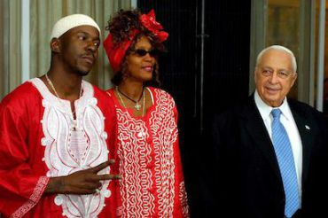 Whitney Houston, center, with Bobby Brown and former Israeli Prime Minister Ariel Sharon, in 2003.