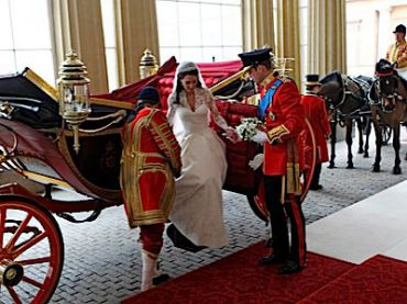 Prince William, Duke of Cambridge, helps Catherine, Duchess of Cambridge, out of a carriage ? upon their arrival at Buckingham Palace.