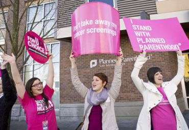 Reproductive rights activists in Seattle show their support for Planned Parenthood.
