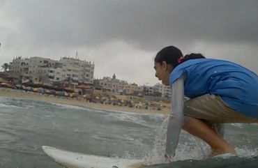 Rawan Abo Ghanem on her surfboard.
