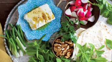 Feastly Fixings: Persian meals are often accompanied by plates of herbs, nuts and vegetables.