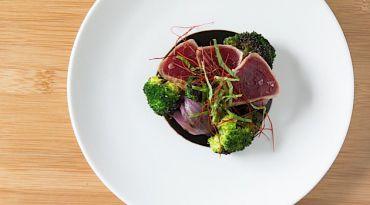 Israeli-Style Ink: Shalom Japan?s Tuna Tataki places perfectly seared tuna atop jet-black tahini.