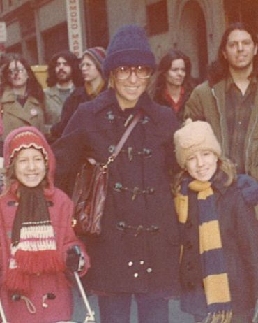 Letty Cottin Pogrebin marches for feminism in lower Manhattan circa 1973 with twin daughters Robin (l) and Abigail (r), then age 8.