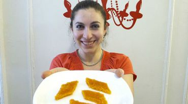 Carrot Candy: Beth Pollak, who?s family is South African shows off a plate of sweet and spicy ingberlach in her Brooklyn home.