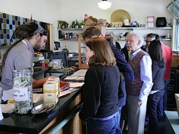 Hungry diners await Wise Sons? signature deli sandwiches.