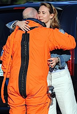 Rep. Gabrielle Giffords hugs her spacesuit-clad husband Mark Kelly in 2008.