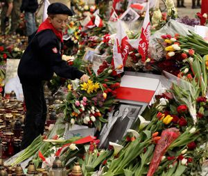 National Loss: A Polish boy scout arranges flowers left by mourners next to a portrait of Polish President Lech Kaczynski outside the presidential palace in Warsaw. The nation was plunged into grief by the death of Kaczynski and dozens other national figures in an April 10 plane crash.