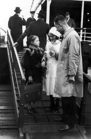 Imparting History: The idea of separation from a child, Wildman writes, is abhorrent ? in a camp, or outside one. Above, a German Jewish girl is met at Harwich, England, by a representative involved in the Kindertransport in 1938.
