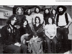 Members of the Videofreex collective pose in a Manhattan loft circa 1970. The author?s father, Chuck Kennedy, stands in the top row, second from left. Photoshopped from an original by Bill Cox, courtesy of Videofreex.com.