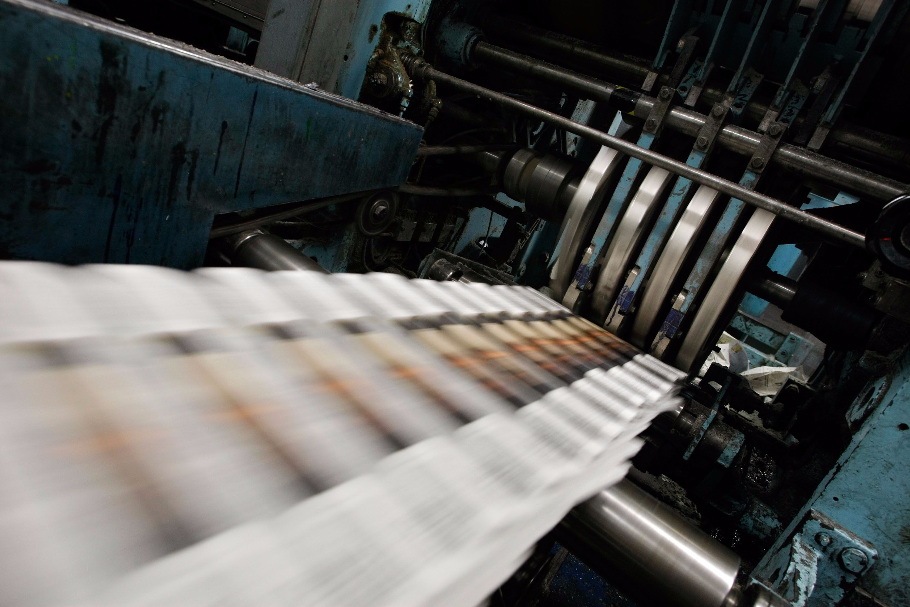 Newspapers on the printer.