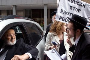 Angry Exchange: Agudath Israel of America trustee Israel Lefkowitz, in his car, argues with Rabbi Nachem Rosenberg (left) and Levi Goldberg (right), with a reporter listening in front of a Manhattan hotel.
