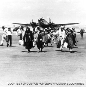 HOME AWAY FROM HOME: An airplane arrives in Israel carrying Jewish refugees from Iraq, circa 1955