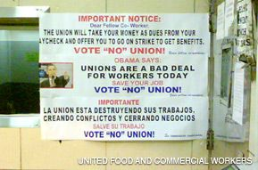 Workers took a picture of banners that were put up inside the Alle Processing kosher meat facility before a union vote.