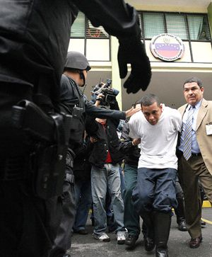 Attacks Rise: Police take away a suspect in the desecration of a Venezuelan synagogue, one of many incidents that has raised concern about the increase in antisemitism around the globe.