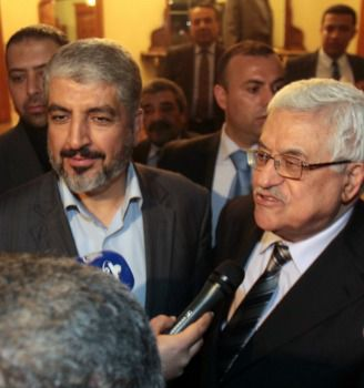 Hamas leader Khaled Meshaal (left) and Palestinian Authority head Mahmoud Abbas in Cairo, February 2012, announcing what they thought was successful completion of unity pact.