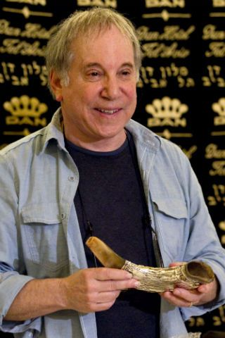 Paul Simon receives a shofar after the press conference in Tel Aviv.