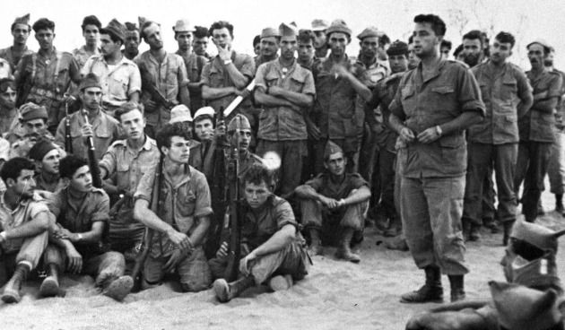 Ariel Sharon addresses his troops as Unit 101 prepares to enter Khan Yunis in Gaza, August 30, 1955.
