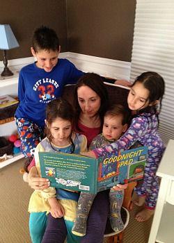Nina Badzin reads with her children.