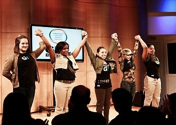 Girl Be Heard performs at an AJWS event.