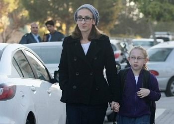 Hadassah Margolese walks her daughter, Na?ama, to school in Beit Shemesh after the girl was harassed by ultra-Orthodox men.