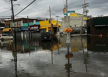 Flood damaged streets in Queens due to Hurricane Sandy.