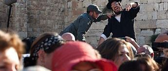An ultra-Orthodox protestor clashes with an Israeli police officer during a prayer service held by Women Of The Wall on May 10, 2013 in Jerusalem.