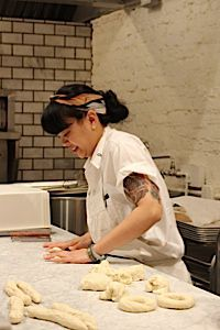 Baker Dianna Daoheung rolls out bagels at Black Seed on opening morning.