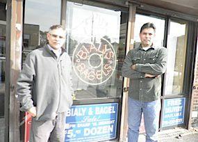 Zafaryab Ali andPeerzada Shah pose outside their new shop.