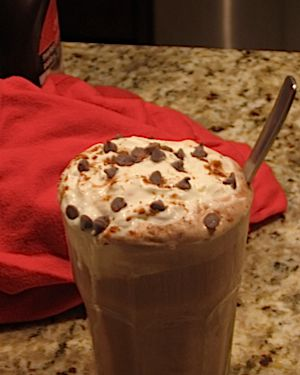 A chocolate cherry ice cream float.