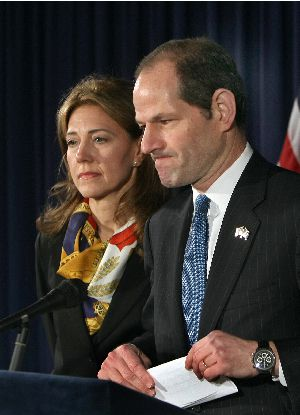 Eliot Spitzer addresses the media with his wife Silda Wall to announce that he will resign from office after revelations that he had been a client of a prostitution ring.